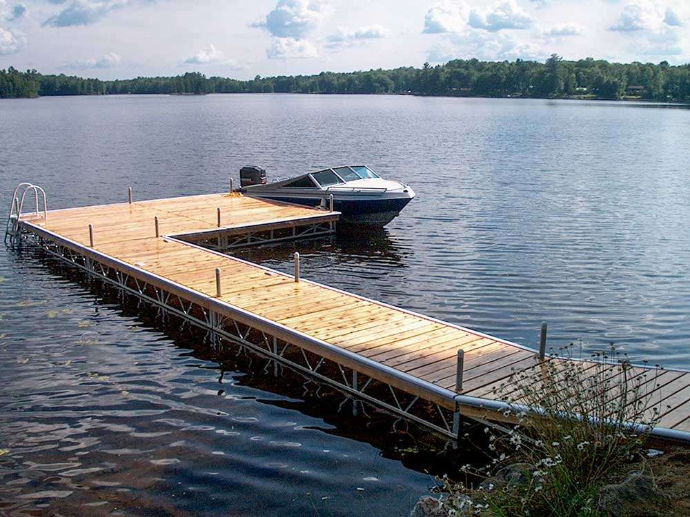 A boat parked at an L-shaped Pipe Dock.